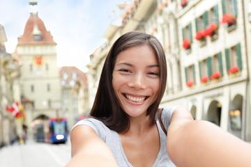 Woman taking selfie in Bern Switzerland