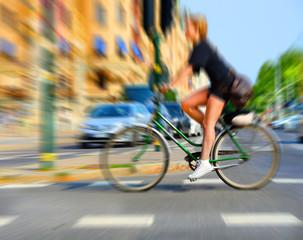 Fototapete - Woman in dagerous traffic, zoom blur