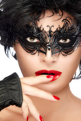 Beauty Fashion Model Woman Face in Black Masquerade Eye Makeup
