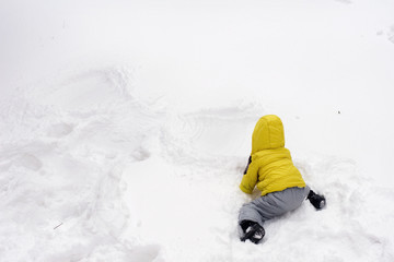 A little kid and a snow angel