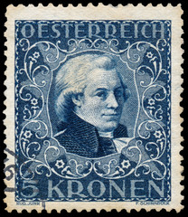 Stamp printed in Austria shows portrait of  Mozart