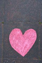 Heart drawn in chalk on a sidewalk