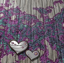 Decorated wooden board with metallic hearts