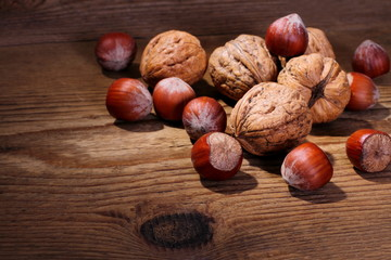 Ripe, healthy nuts on wood background