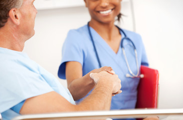 Hospital: Nurse and Patient Shake Hands