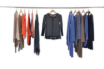 Multi colored female shirts with sundress on hangers