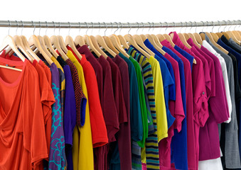 Variety of female colorful clothes on Hangers