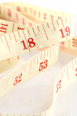 Tape Measure on White Background in Weight Control Concept.