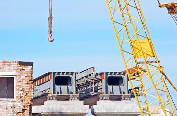 Bridge construction site over blue sky background