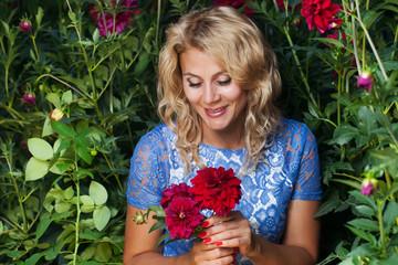 Beautiful girl in the flower garden