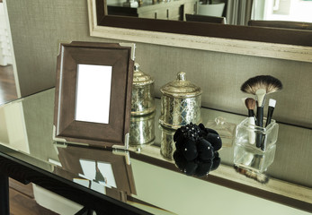 Beauty and make-up concept: picture frame, jewelry and makeup br