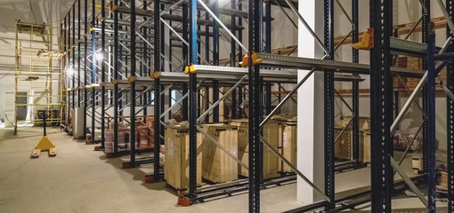 Warehouse interior with empty shelves