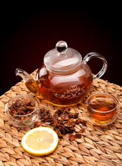 Cup of tea with teapot. With lemon and star anise