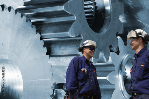 Wall mural engineers with titanium and steel cogwheels and gears