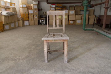 Old wooden chair in a warehouse