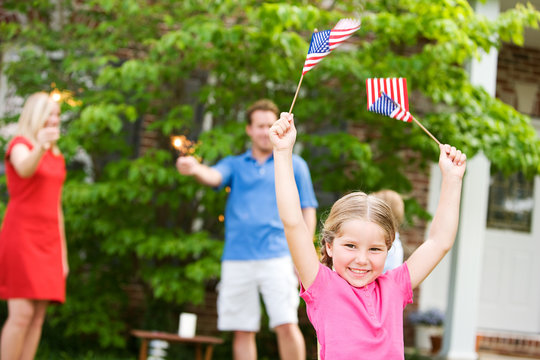 Summer: Girl In Front Yard with American Flags