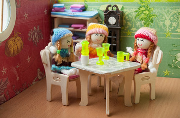 dolls at the table