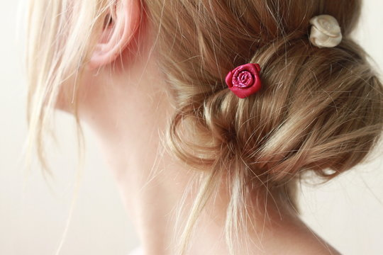blond woman with hair pin
