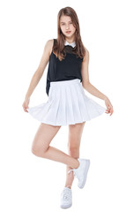 Young fashion girl in white skirt posing isolated