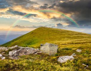 white boulders on the hillside at sunrise