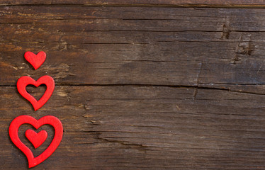 Rustic hearts on a wooden background