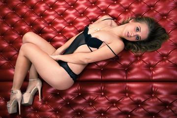Sensual beautiful blonde woman lying in bed
