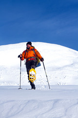 Hiker in winter mountains