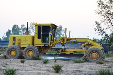 Machine on Land for construction at sunset time