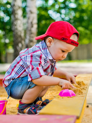 child plays with sand