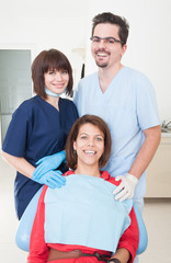 Happy dentist woman, assistant and patient