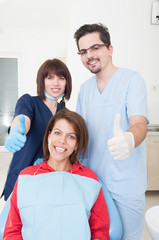 Dentist team and patient with thumbs-up