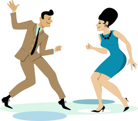 Couple dressed in early 1960s fashion dancing twist
