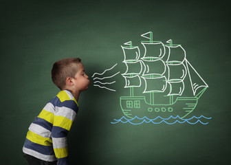 Child blowing a chalk sailboat