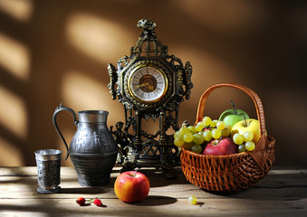 Metal pitcher and fruit