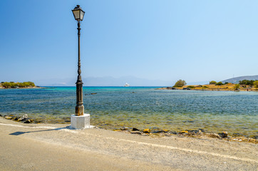 Old street lamp near the road in Aghios Nikolaos town