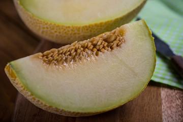 Melon fruit cut on rustic wooden board