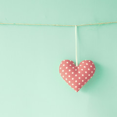 Vintage cotton heart hanging from a line