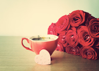 Bouquet of red roses, hand-painted wood heart and coffee cup