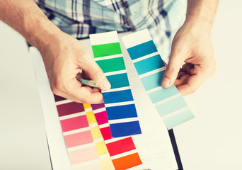 man with color samples for selection