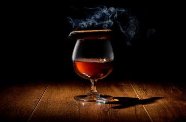 Cigar on wineglass