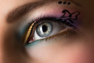 Close-up of woman eye with colorful make-up.