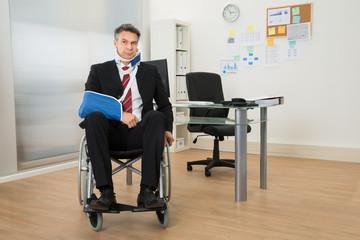 Handicapped Businessman Sitting On Wheelchair