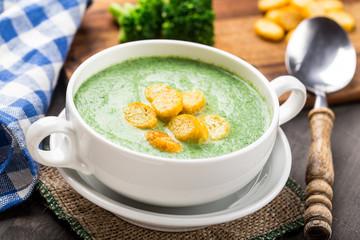 Broccoli cream soup on table