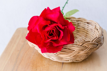 Red rose in wicker basket for valentine's day