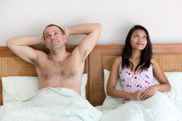 woman with man in bed dreaming