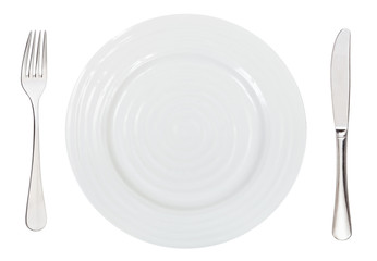 top view of empty white dinner plate with cutlery