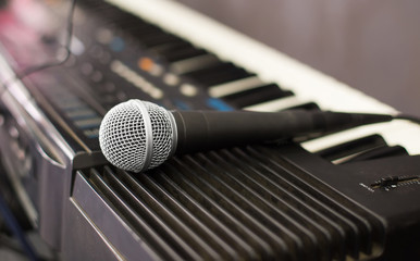 Microphone and electronic keyboard. Are isolated on a white back