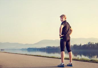 Young man runner before start