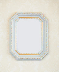 Classic white golden empty frame on wall