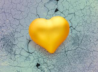 Golden heart on cracked background